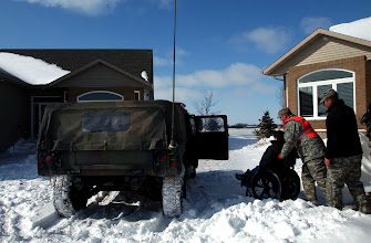 Photo: Soldiers from Company A, 2nd Combined Arms Battalion, 136th Infantry Regiment, evacuate a Moorhead, Minn., resident after flooding from the Red River cutoff roadways in the area, Friday, March 27, 2009. The Red River continues to rise as a result of rain and snowmelt and is expected to crest at 43 feet, three feet higher than the current flood record. More than 500 Minnesota National Guard Soldiers and Airmen have been called up to state active duty to assist local authorities with traffic control, security as well as other tasks.(U.S. Army photo by Staff Sgt. Jon Soucy)(released)