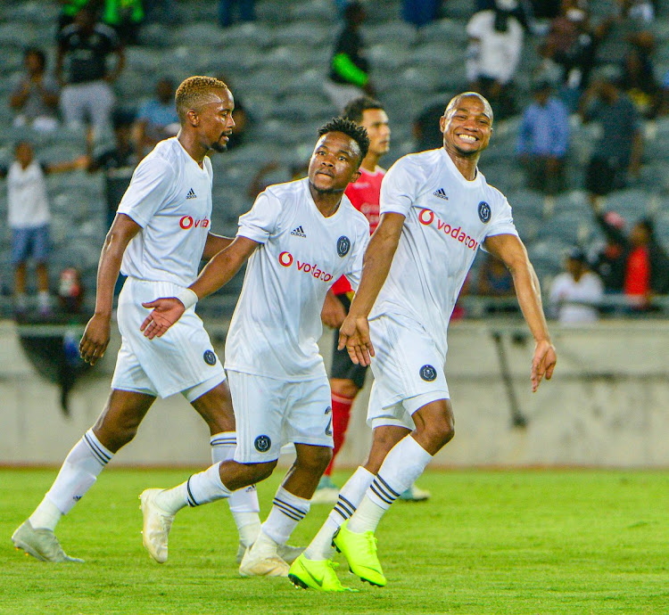 Orlando Pirates' winger Thabo Qalinge (right) celebrates with teammates Paseka Mako (centre) and Linda Mntambo (left) after scoring the opening goal in a 5-1 Caf Champions League preliminary stage first leg win over Light Stars FC of the Seychelles at Orlando Stadium, November 28 2018. Picture: ORLANDO PIRATES/TWITTER