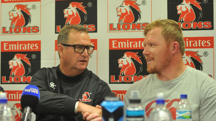 The Emirates Lions head coach Swys de Bruin congratulates Jacques van Rooyen on his 50th Cap during a press conference on 15 February 2018 at Ellis Park.