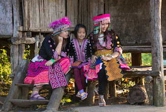 Photo: Locals wearing traditional dress (for special occasions and tourists). The faces of the Hmong are noticeably rounder than is typical in Thailand, even accounting for the age of these children.