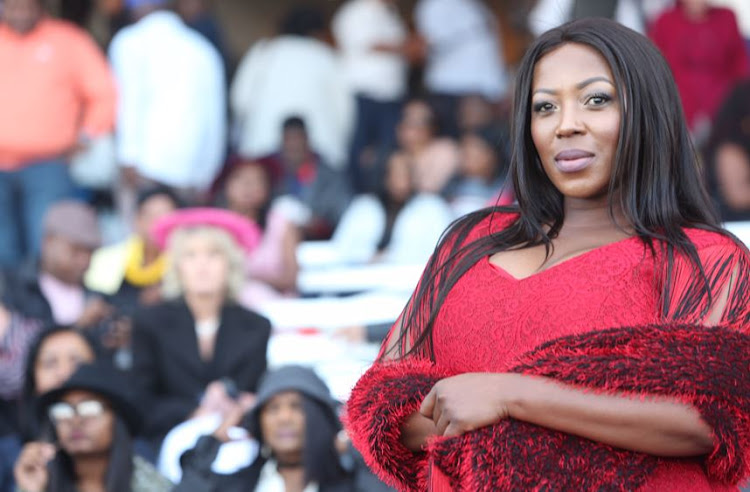 In classy red: Rami Chuene from 'The Queen' at The Vodacom Durban July.