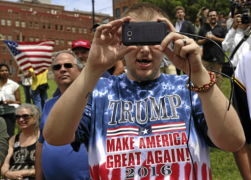 One for the record: A supporter of then Republican presidential candidate Donald Trump takes a picture at a pro-Trump rally near the Republican National Convention in Cleveland, Ohio in 2016. Picture: REUTERS