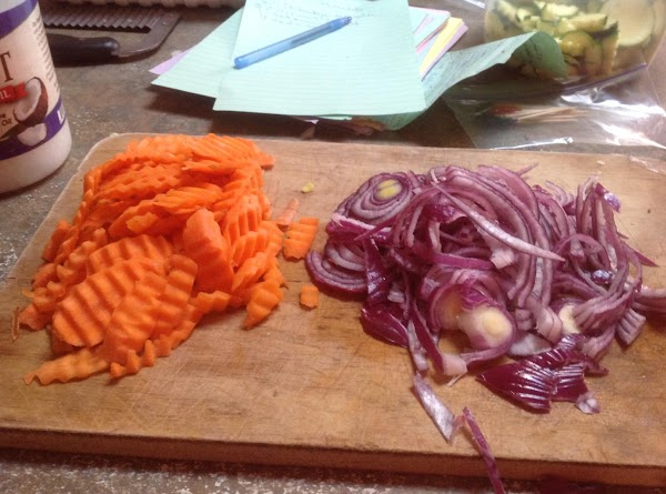 Peel & Slice the red onions.