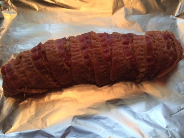 Take pre-cooked bacon and wrap around width of tenderloin halves and secure with toothpicks....