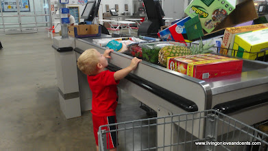 Photo: Little man helped me load up at check out. I think he was making sure I did not forget his chips or movie.