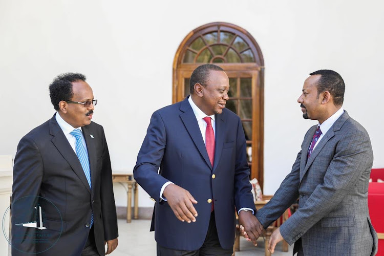 Somali President Mohamed Farmajo, Kenyan President Uhuru Kenyatta and Ethiopian Prime Minister Abiy Ahmed after a meeting at State House Nairobi on March 6, 2019 to discuss extensively on the source of the Kenya-Somalia border dispute.