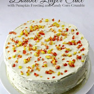 Double Layer Cake with Pumpkin Frosting and Candy Corn Crumble