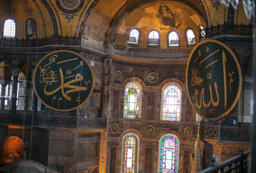 Inside-Hagia-Sophia-8.jpg - Second-story view of magnificent hand-painted signage with sayings from the Koran adorn the walls of Hagia Sophia in Istanbul.