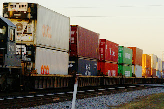 Photo: A colorful train of stacked cargo boxes