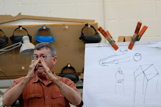 Photo: Ernie explained angles on his tools.  He used the drawings and his hands to describe the angles of his tools and why he uses them.