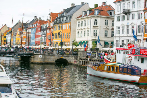 Tourists crowd the canal area of the Nyhavn neighborhood of Copenhagen.