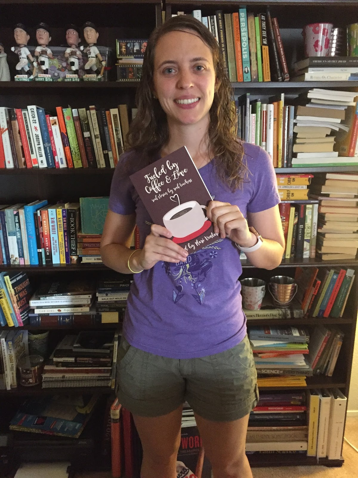 I'm holding my copy of the Fueled by Coffee and Love proof!