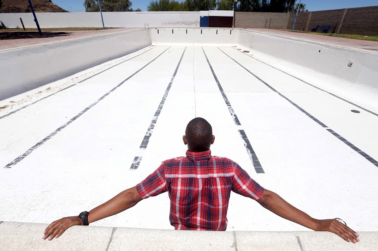 Errol van der Horst in the empty swimming pool in Bird Street on November 08, 2017. It is one of three community pools that will be closed for the summer because of the drought in Beaufort West.