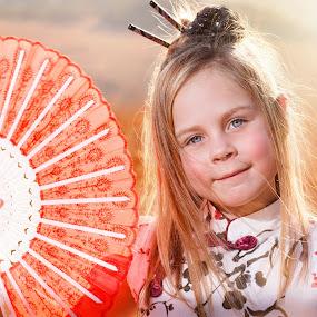 Sunset Angel by Shayne Janks Nicolas - Babies & Children Child Portraits ( colour, orange, little girl, red, dress, pretty girl, sunset, fan, chinese )
