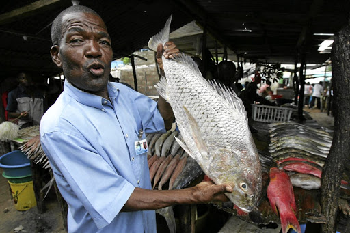 Jacinto Nhaposse is making a living by selling fish at a fish market at the Costa do Sol beach in Maputo.