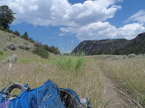 Photo: sitting in a grass field taking a heat break right before our camp site