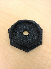 Photo: Inside support removed. This part _didn't_ bond to the walls, but also did bond quite well to the top. I see the appeal of printing in to materials and dissolving one off.