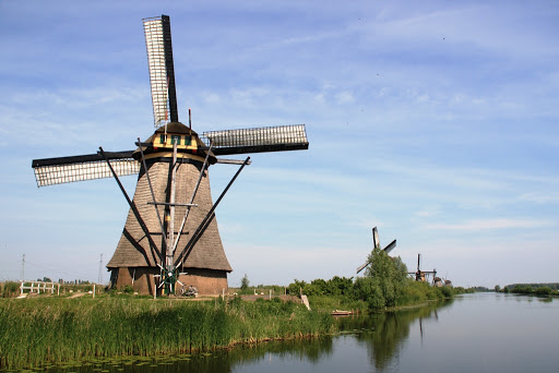 The windmills of Kinderdijk are one of the best-known Dutch tourist sites. Kinderdijk is in a polder where the Lek and Noord rivers meet. To drain the polder, a system of 19 windmills was built around 1740. This group of mills is the largest concentration of old windmills in the Netherlands.