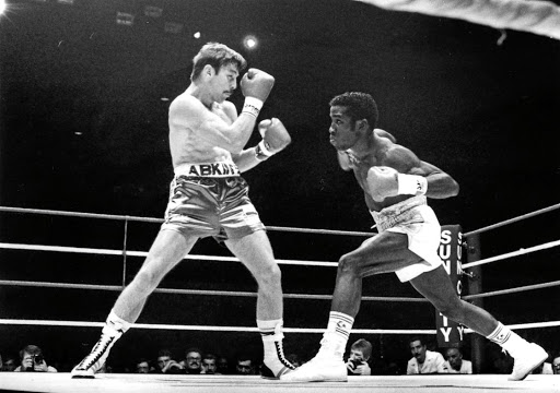 Legendary boxer Brian Mitchell defends his title against Alfredo Layne at the Sun City superbowl.