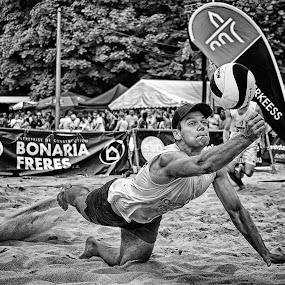 Saving Dive by Marco Bertamé - Black & White Sports ( sand, ball, beach volley, dive, summer, saving, lbo, beach, man, luxembourg )