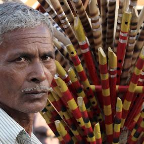 The Flute Seller by Udaybhanu Sarkar - People Portraits of Men ( flute, people, seller, man, portrait,  )