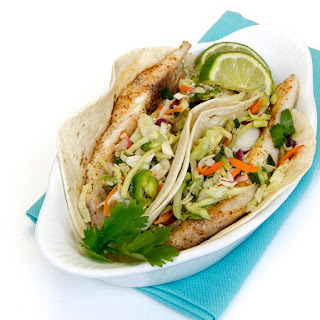 Amberjack Fish Tacos with Zesty Slaw and Avocado Cream.