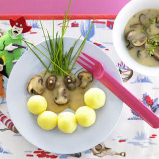 Mini-Kartoffelknödel mit Champignon-Rahmsauce