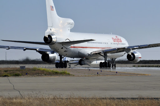 An Orbital Sciences L-1011 aircraft taxis before taking off on a mission to launch NASA's IRIS spacecraft into orbit.