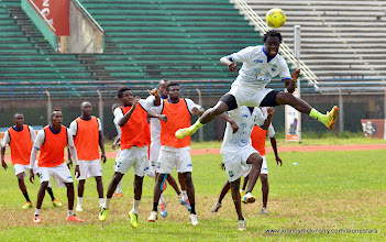 Photo: Kei Kamara leaps to connect with the cross  [Training camp ahead of Leone Stars v Seychelles Game in Freetown on 19 July 2014 (Pic: Darren McKinstry)]