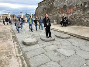 "Photo: The roads of Pompeii often had water flowing down them to clean out the horse droppings. Therefore, pedestrians could use these stone ""crosswalks"" to stay dry while crossing the road."