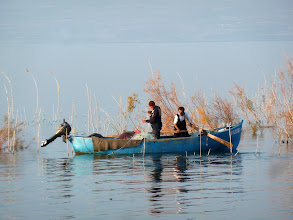 Photo: Fishermen on the Sea of Galilee. These guys did catch a number of fish in their net as Valerie and I watched from the shore.
