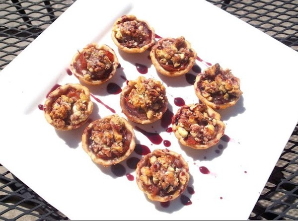 Kenzie's Poached Pear Delites:  pie crust shells topped with poached pears, proscuitto, gorgonzola...