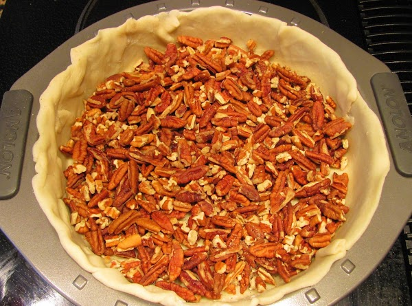 Place pecans in the bottom of the unbaked pie shell.