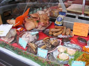 Photo: The local boucherie features some items not likely to be found in the US, such as the pig faces just to the upper left of center.