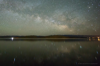 Photo: Eta Aquarid Meteor, Milky Way and Reflection A few days ago I suggested that you could go out in the early morning hours, look east, and look for meteors from the Eta Aquarid meteor shower. All week we've had storms here, so I wasn't able to look for it myself. Yesterday morning, I finally had my chance. I did capture many meteors, but mainly as the apparent source, or radiant point, of the meteor shower rose above the horizon starting around 2:40 am.  Then reviewing my shots I saw this one earlier, around 12:23 am. Was it an Eta Aquarid? Meteors could come shooting up over the horizon a couple of hours before the radiant point in the constellation Aquarius rose, but I think that was going to occur more centered in this picture. So the trail of an Eta Aquarid meteor should be pointing down and to the left, towards a point below the center, almost 90 degrees from this one's path. So although this one appears to the observing camera to be roughly in the sky where many of the meteors did show up 2 to 3 hours later, it doesn't appear to be from the Eta Aquarid meteor shower. Random meteors happen.  Well, Eta Aquarid meteor or not, this meteor's timing was great, streaking through the Milky Way while the lake was calm enough to provide an only slightly blurry reflection of it. It's interesting to notice that the star reflections blur towards the camera as slight waves come towards shore in this long exposure, but the path of the meteor is more erratic because it doesn't stay still as waves make the reflecting surface also move. Too often you'll see a photo with a perfect mirror reflection of the stars. Can an entire lake be a perfectly flat mirror for the 30 seconds typically required to capture a star shot like this? A small puddle perhaps, and a reflection in a lake looks mirror smooth for a short sunset exposure, but over the course of a long exposure, lake surfaces move. I haven't seen a real lake provide a Photoshop-like mirror surface for a long dark sky exp