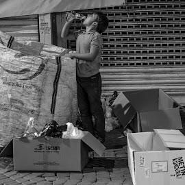 Childhoods end by Grigoris Koulouriotis - People Street & Candids ( street life, night photography, night, turkey, street scene, working, boy, izmir, street photography )