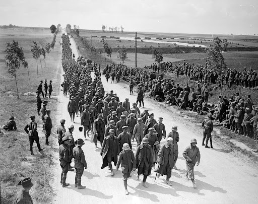 German prisoners arriving at a temporary POW camp near Amiens, 9 August 1918.