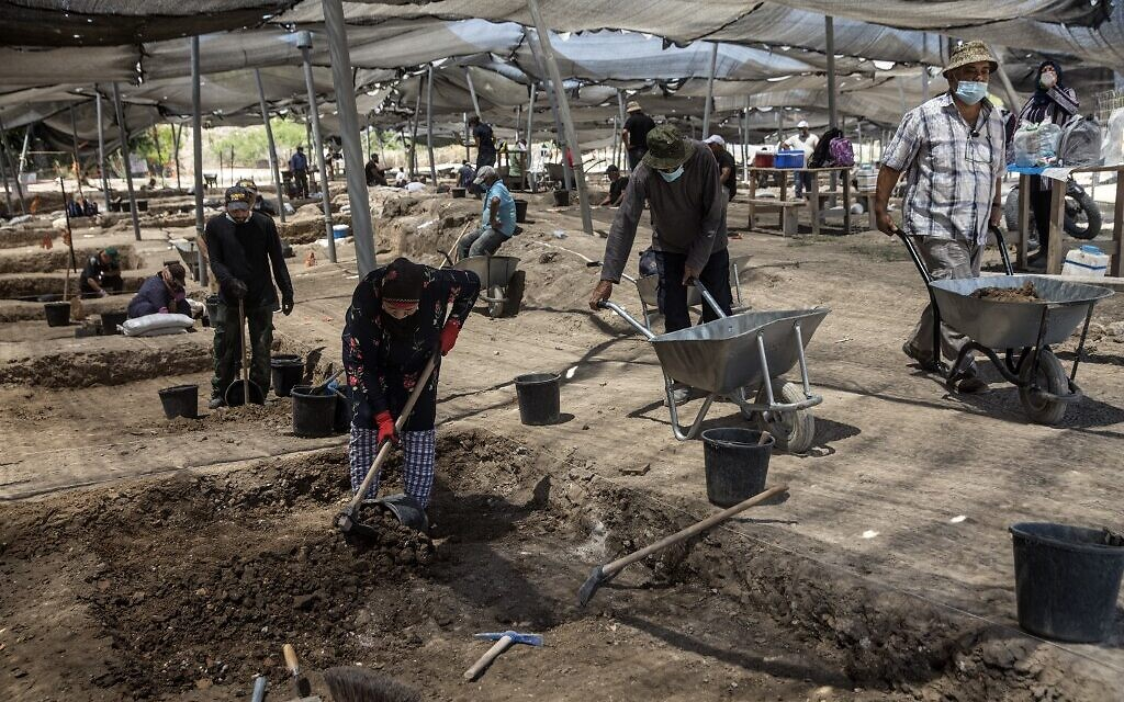Workers excavate a site where a hoard of gold coins dating to the Abbasid Caliphate was unearthed, at an archeological site near Tel Aviv in central Israel (Heidi Levine / POOL / AFP)
