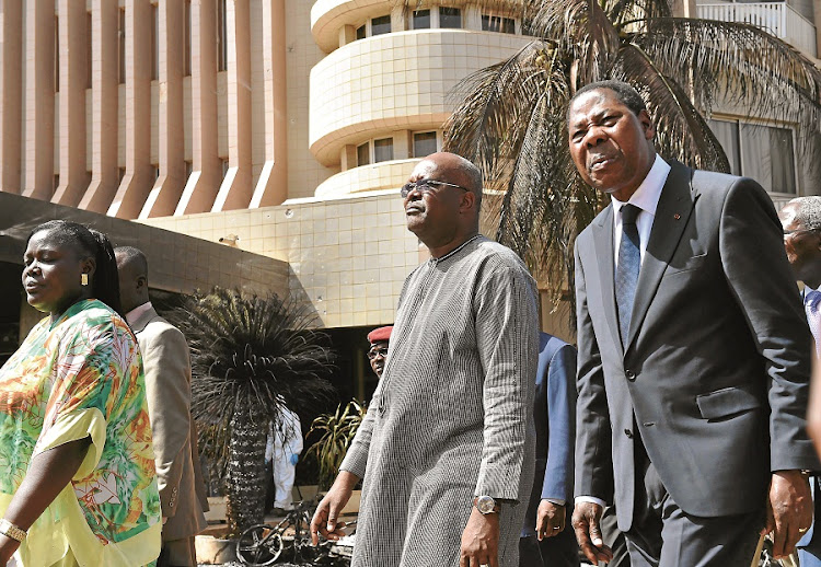 The president of Burkina Faso, Roch Marc Christian Kabore, and Benin's Thomas Boni Yayi visit the Splendid Hotel in Ouagadougou, after an attack by Al-Qaeda that left 29 dead. It follows an earlier attack on a hotel in Mali. Picture: GALLO IMAGES/AFP/ISSOUF SANOGO