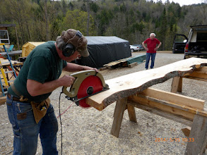 Photo: Dad watches Chris cut the counter slab.