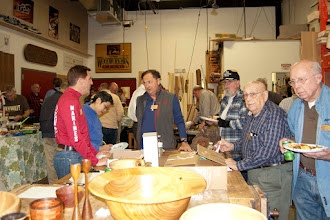 Photo: Part of the fine crowd of over 40 Members, in fine pre-holiday spirits: eating, conversing, and checking out the Show Tell & Ask pieces.