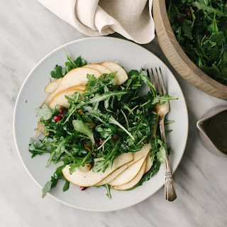 Arugula Pear Salad with Pistachios and Pomegranate Seeds Recipe