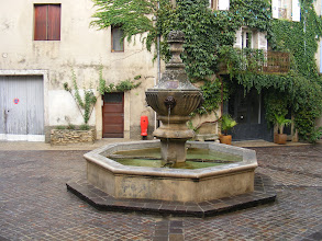 Photo: The central village square often includes a fountain, as here.
