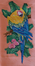 Photo: Completed 23 Mar 2008. Paradise Macaw (1990) by Paul Brent printed by Color Charts, Inc. Stitched on 32ct Tangerine Sparkle Lugana from Silkweaver using DMC fibers. Stitch count: 100w x 205h.