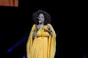Oprah Winfrey during the Global Citizen Festival: Mandela 100 at FNB Stadium, Soweto in a Gert Johan-Coetzee dress.
