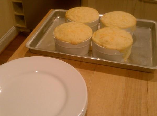 In a medium bowl combine baking mix, cornmeal, garlic powder and cheddar cheese; stir...
