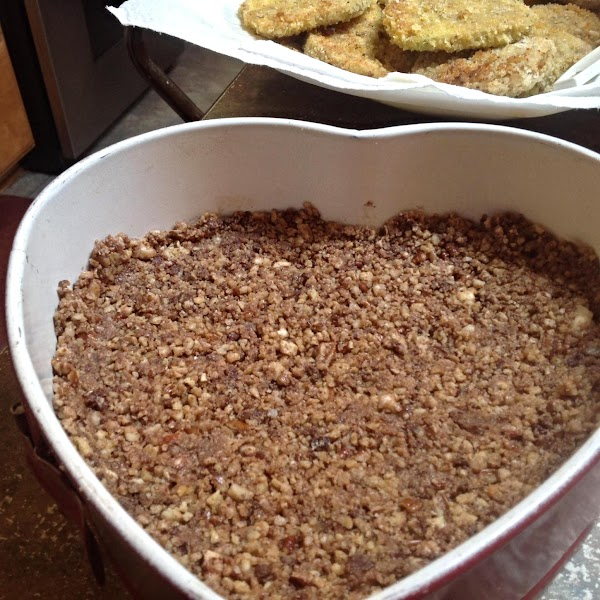 Pour crumb mixture into a 9 inch Springform cheesecake pan. Press crumbs down into...