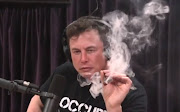A screen grab of Elon Musk smoking weed on a webcast of the Joe Rogan Experience.