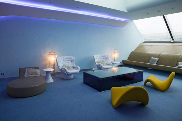 Interior view of modern seating furniture in first class lounge of Virgin Airlines at Heathrow Airport in London.