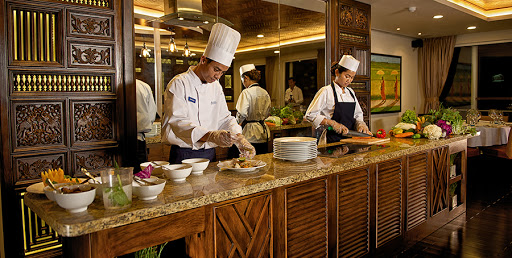Avalon-Siem-Reap-chef - Avalon Siem Reap's live cooking station showcases local specialities prepared by the ship's head chef.